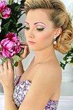 Beautiful woman in violet  dress in luxury studio.