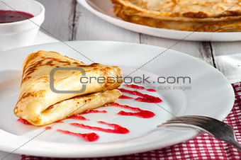 folded pancake on white plate