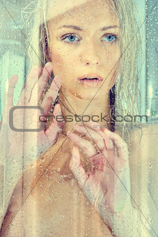 Beatiful blonde naked woman in a shower.