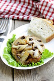 pork steak with mushroom sauce on a white plate