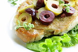 pork steak with green and black olives for garnish