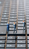 Businessman figurines on laptop