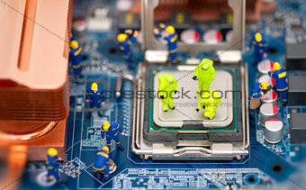Group of technicians repair computer