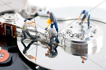 Group of workers repair hard drive