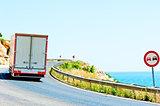 truck on a dangerous road along the sea
