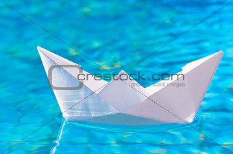 paper boat on the water in the pool