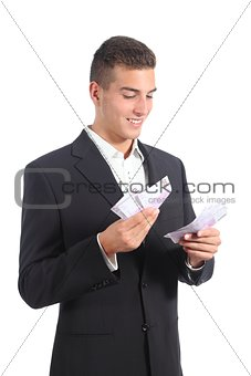 Attractive businessman counting money