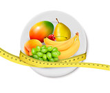 Diet meal. Fruit in a plate with measuring tape. Concept of diet