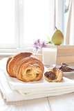 Croissants on table with chocolate