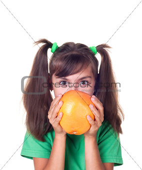 little girl with grapefruit