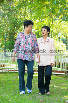 Asian senior women walking at outdoor park.