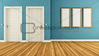 Empty blue room with doors