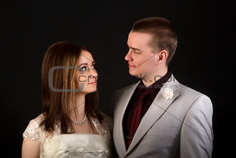 bride and groom on a black background