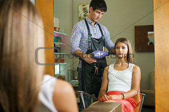 woman in hairdresser shop blow drying long hair