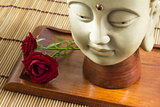 Buddha with rose