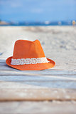 Orange hat on the beach