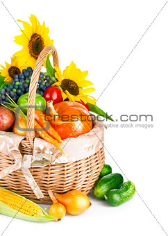 autumnal harvest vegetables and fruits in basket