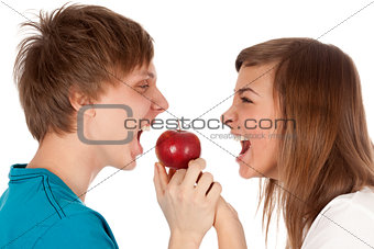 boy and a girl biting the apple