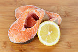 fresh trout steaks on cutting board