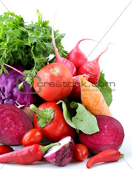 assorted different red vegetable (tomato, pepper, chili, carrots, beets, cabbage, radishes)