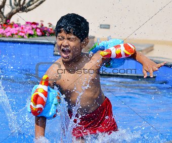 Asian Boy in Swimming practice