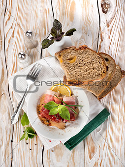 Bacon and bread on a wooden table