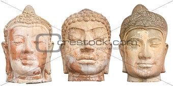 Three Buddha heads isolated on white