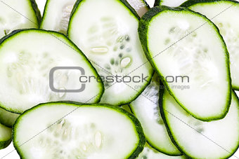 Slices of green cucumbers background