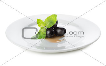 Olives on a white plate