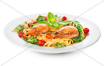 Spaghetti with prawns isolated on white