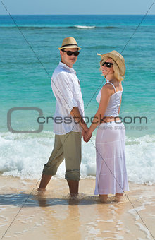 Happy young couple enjoying at beach