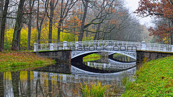 Autumn landscape with river and bridge in Catherine park, Pushki