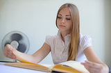 the girl reading the book on a light background