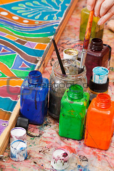 paintbrushes and bottles with color pigments