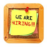 We are Hiring. Yellow Sticker on Bulletin.