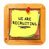 We are Recruiting. Yellow Sticker on Bulletin.