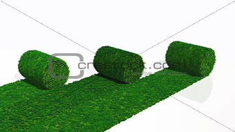 three rolls of grass carpet