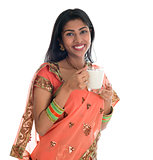 Indian woman drinking milk