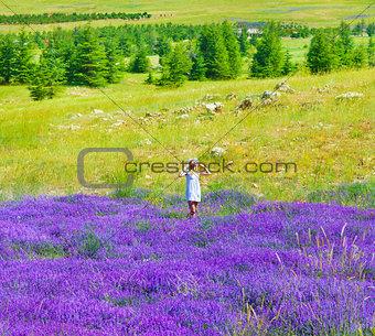 Beautiful girl enjoying lavender field