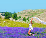 Beautiful girl dancing on lavender field