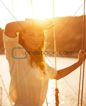 Beautiful woman on yacht on sunset