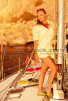 Beautiful model on the yacht on sunset