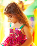 Beautiful little girl dancing over colorful background