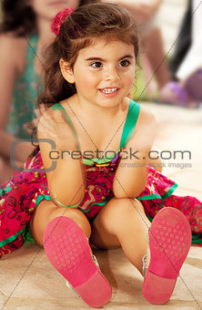 Little cheerful baby girl clap one's hands