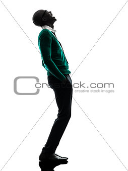 african black man standing looking up  laughing silhouette