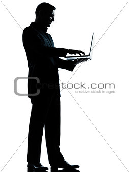one business man silhouette computing computer laptop
