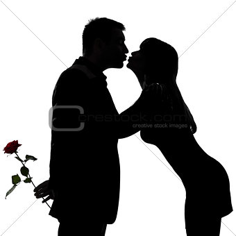 one couple man hiding rose flower and woman kissing
