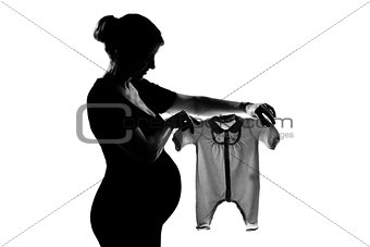 one pregnant woman holding baby clothes