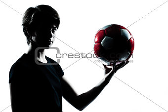 one  teenager boy  girl silhouette holding showing soccer footba