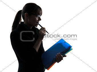 business woman focused  holding folders files silhouette